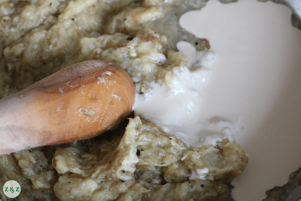 Add tahini, lemon, salt, crushed garlic