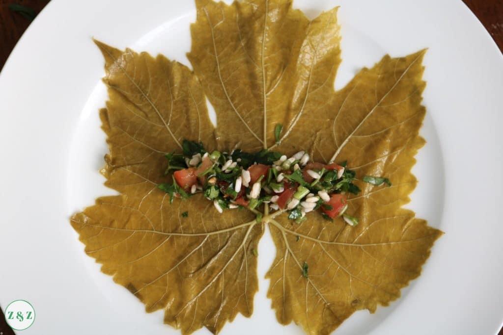 spread 1 tbsp of mixture onto the vine leaf