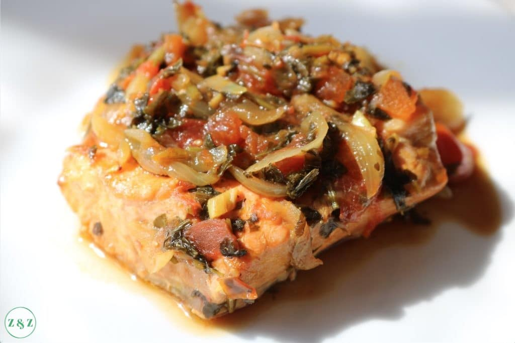 Salmon fillet with tomato and herb relish