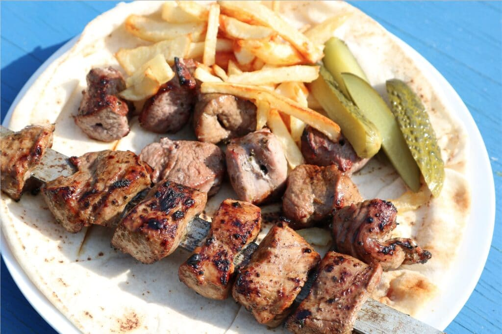lebanese lamb skewer with chips and pickles
