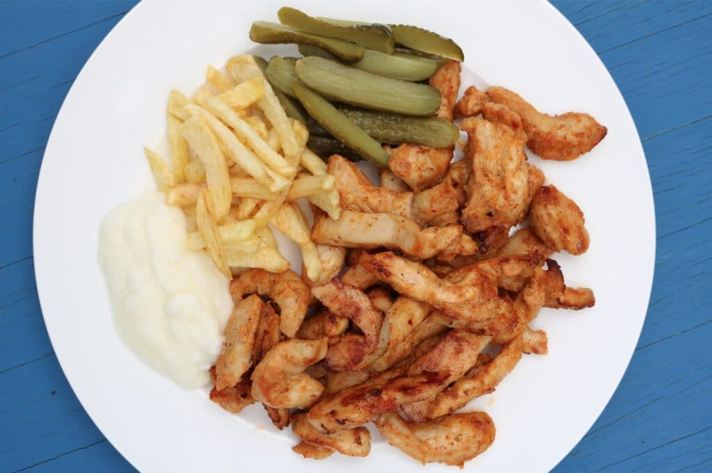 chicken shawarma with pickles, chips and garlic sauce
