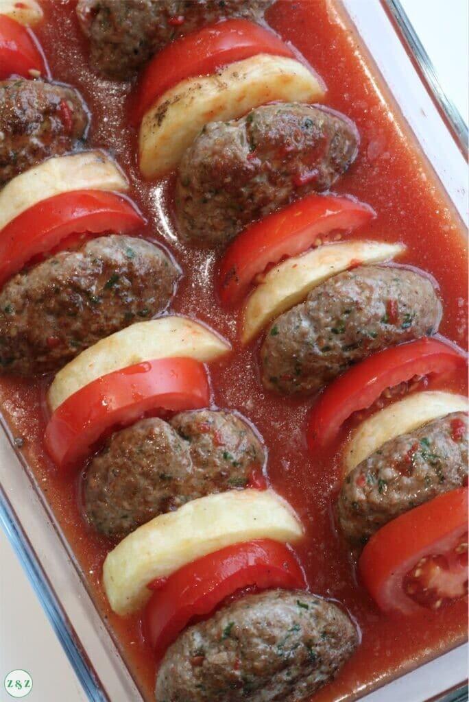 kafta bil sanieh in tomato sauce
